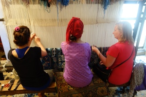 Rita acquiring domestic skills. Weaving a rug by hand, it takes over a million knots and one full year to make.