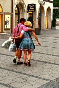 Lovely couple walking along the streets of Munich. A LOT of them dress like this every day for no reason.