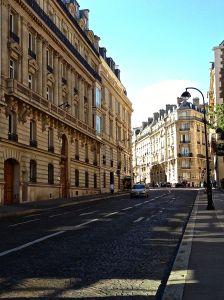 Normal street in Paris without trees. Most of them have some trees though.