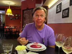 "Norm eating ""Borscht"" soup! He HATES beets and this is made out of beetroots!! But you have to eat the local food. It's a rule, kinda like the ""carry-on"" luggage only. LOL!"