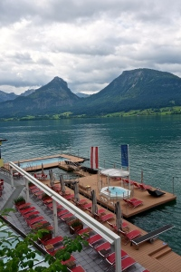 This is the view of the pool, hot tub and lake swimming area. The large pool at the end is solid stainless steel, kept at 86 degrees year round and is floating in the dock, next to it is the cold lake plunge pool, and the little pool under the flags is the hot tub. All floating. Pretty cool.