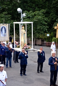 The replica of the statue of Mary as it is being carried by the leaders of the procession.