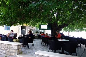 Oh, my, another place to have drinks outside, and with a TV screen in the trees!