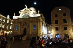 Our live entertainment in the middle square of Old Town. Notice the beautiful stained glass windows that light up in St. Blaise church in the background.? (St. Blaise is the patron saint of Dubrovnik)