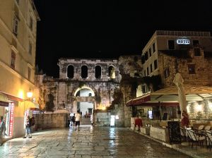 """One of the entrances to the Diocletian's Palace grounds, yes this hotel sign is inside the """"grounds""""."""