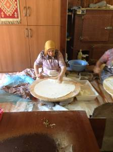 Look at how she sits with her legs out ALL DAY, preparing this Turkish bread!
