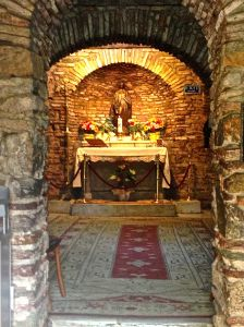 The shrine built where the fireplace was in honor of Mary.