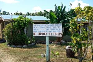 These signs are posted everywhere in Aitutaki!