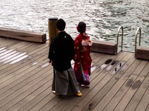 """Japanese wedding in front of our hotel, this is part of their photo shoot. Photographer was taking their picture """"showing them walking the harbor""""."""