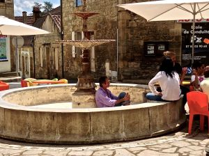 We think this is what the French do when there is no water in the fountain and sunny skies above!