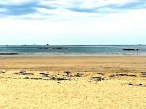 The beach at Dinard. Notice the low tide and wide sandy beach.