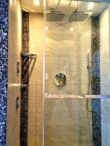 This is one of the modern showers we blogged about.  It has two rain shower heads and jet sprays on the sides.  It also has a sign about saving the world by not laundering towels each day!!