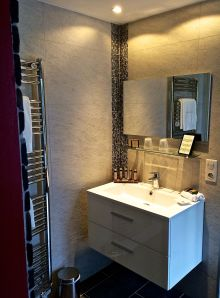 Modern, or Contemporary Vanity, with towel warmer for those cool mornings.