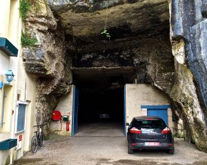 To the left of our car is a limestone cave that our hotel was using as a parking garage! We didn't go into the cave. We were afraid there may be troglodytes in it!