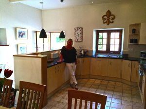 Photo of kitchen with Chef.