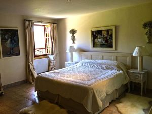 Photo of master bedroom.  No screens or air conditioning.  You have to make choices.  It does have a heated pool.