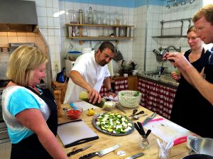 Here we are with Ian putting on the finshing touches to our green salad we all made in class!  Thank goodness Ian didn't ban our iPhones!