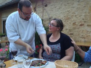 Angela getting instructions on how to cut her beef the french way!