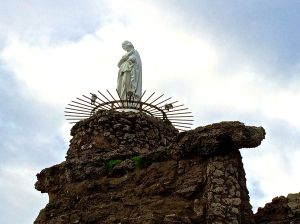 Statute of the Virgin Mary at the entrance to the harbor at Biarritz.