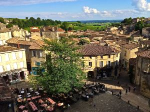 "The central ""place"" in St. Emilion, another wine area of Bordeaux is dotted with outdoor restaurants serving good food and wine."