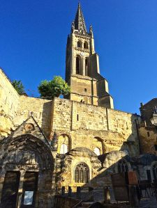 "A photo of the Church of St. Emilion from the town ""place""."