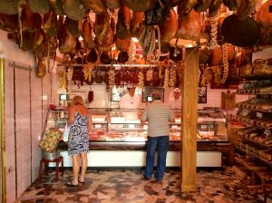 This is the butcher shop that covers three store fronts on the Greve main square.  It has been doing so since 1806.  It specializes in pork and the hanging hams you see in the photo.
