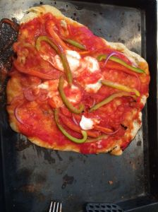 Voila!!  Our very first wood grilled pizza!  How did we do?