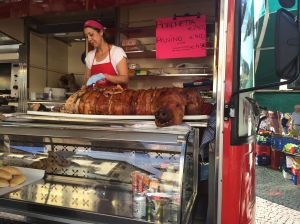 Happy roast pig at one of the few food vendors at the Greve market.