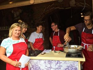 This is Rita, our group and our instructor in the white t-shirt at our Certaldo Italian cooking class.  Class included English, Danes, and Australians.